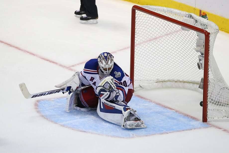 Henrik Lundqvist can't stop Dustin Brown's redirection, resulting in the winning goal in the second overtime. Photo: Bruce Bennett, Getty Images