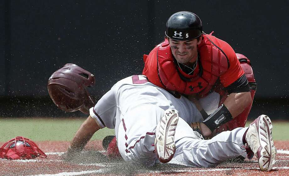 Brandon Glazer of the College of Charleston is tagged out by Texas Tech catcher Hunter Redman, one of two times he was retired at the plate in their super regional game in Lubbock. Photo: Shannon Wilson / Lubbock Avalanche-Journal / Lubbock Avalanche-Journal