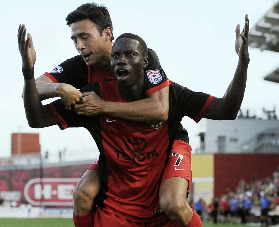 The Scorpions' Sainey Touray (front) celebrates a goal with Walter Restrepo during Saturday night's late game against the Fort Lauderdale Strikers at Toyota Field. Photo: Darren Abate / For The Express-News / Darren Abate/DA Media, LLC