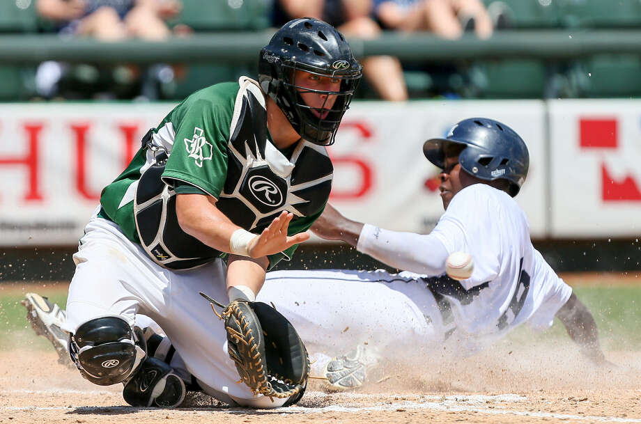 Flower Mound's Jameson Hannah slides in for a run as Reagan catcher Leyton Leone fields the ball. The Rattlers lost the Class 5A state title game 10-0 via the mercy rule. Photo: Marvin Pfeiffer / San Antonio Express-News / Express-News 2014