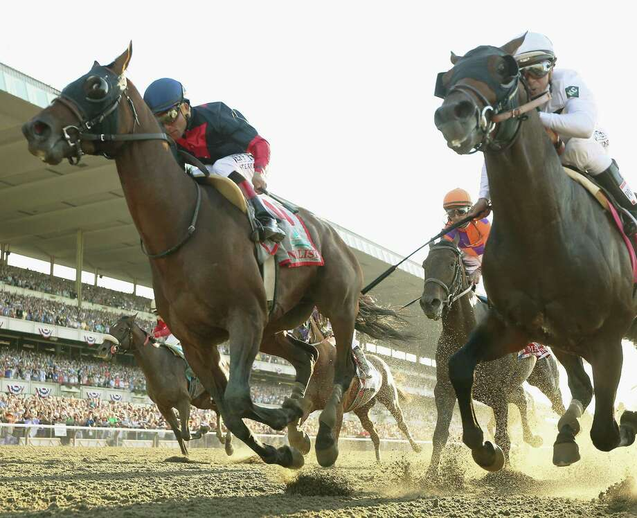 Tonalist (front left), ridden by Joel Rosario, wins the 146th Belmont Stakes, spoiling heavy favorite California Chrome's bid to become the first Triple Crown winner since 1978. Photo: Rob Carr / Getty Images / 2014 Getty Images