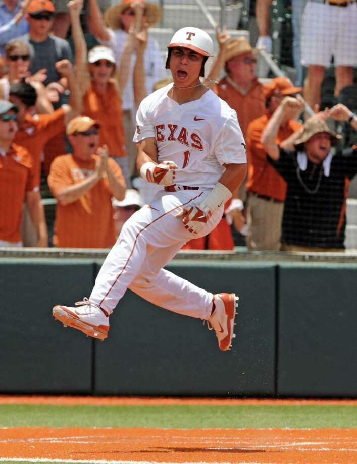 Tres Barrera scores during the Longhorns' four-run fourth inning during a 4-0 Austin Super Regional win at Disch-Falk Field, sending UT back to Omaha for the first time since 2011. Photo: Eric Christian Smith / For The Houston Chronicle