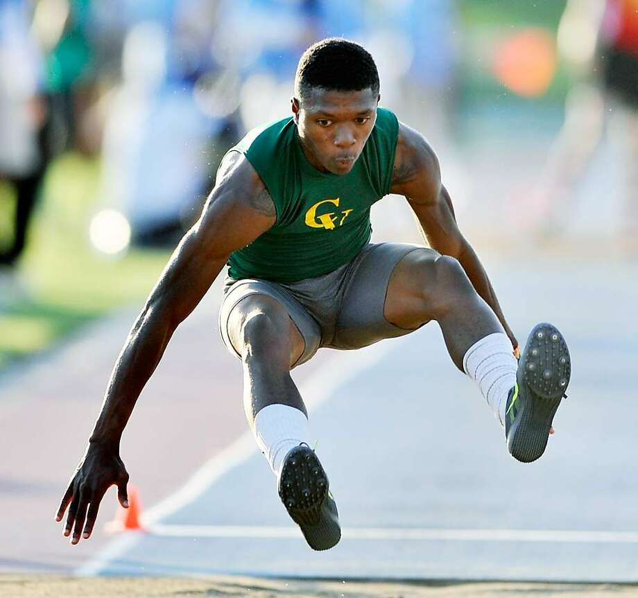 Castro Valley High School senior Nate Moore competes the long  jump during CIF State Championships at Buchanan High School in Clovis, Calif. He won both the long and triple jump events in leading national marks. He defended both titles. Photo: Eric Taylor, Special To The Chronicle