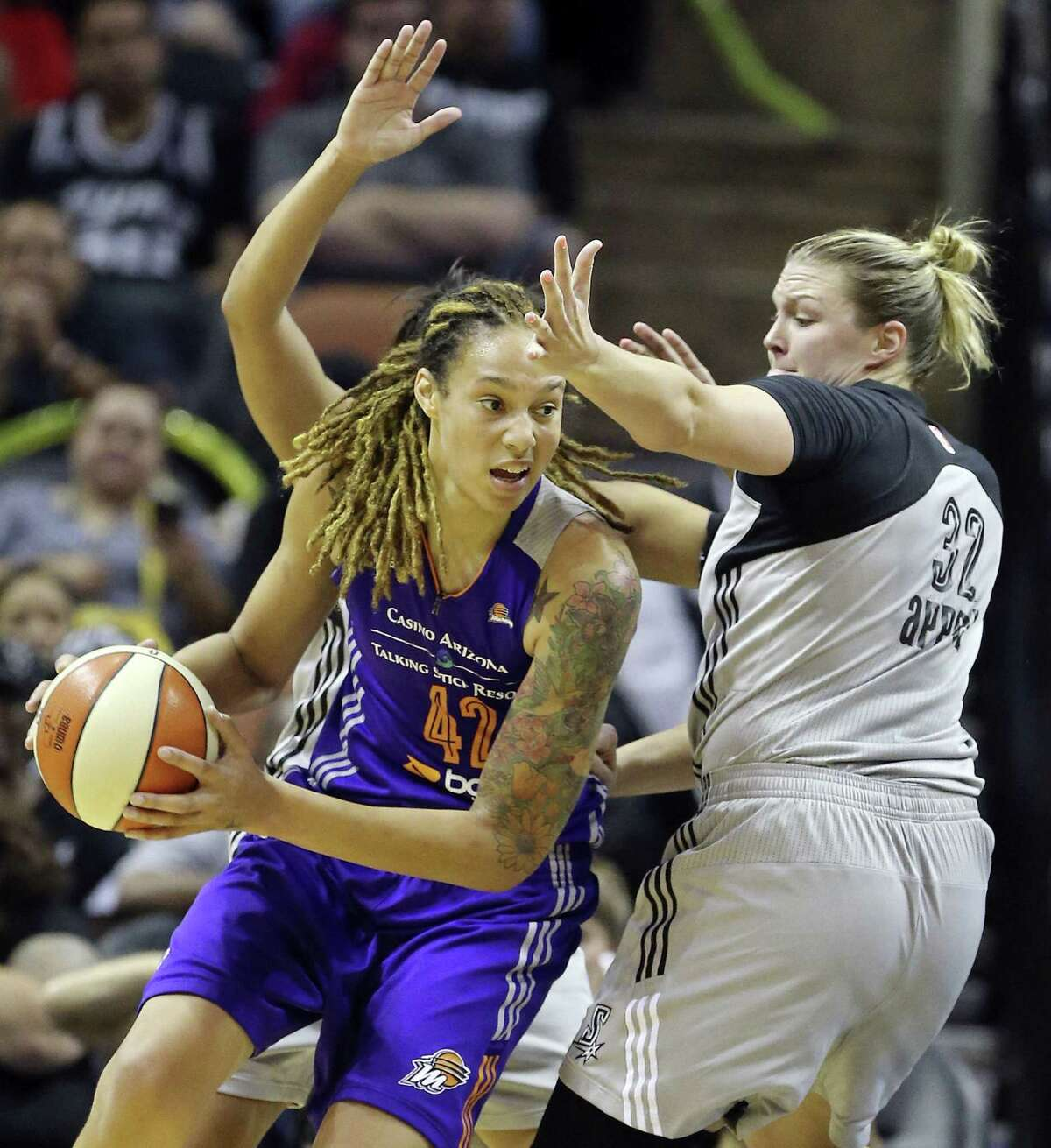 Phoenix center and former Baylor star Brittney Griner looks for post position on the Stars' Jayne Appel on Saturday night at the AT&T Center. Griner had 16 points and 18 rebounds in the Mercury's double-overtime victory.