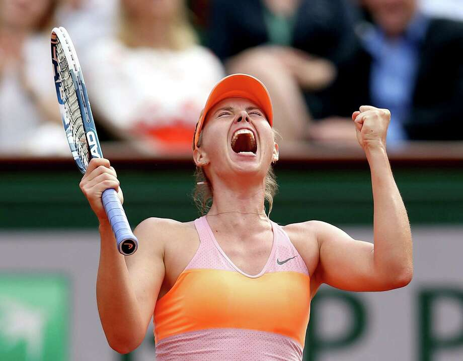 Maria Sharapova yells after scoring a point in her 6-4, 6-7 (5), 6-4 victory over Simona Halep. Sharapova, who was in her third straight French Open final, also won the tournament in 2012. Photo: Matthew Stockman / Getty Images / 2014 Getty Images