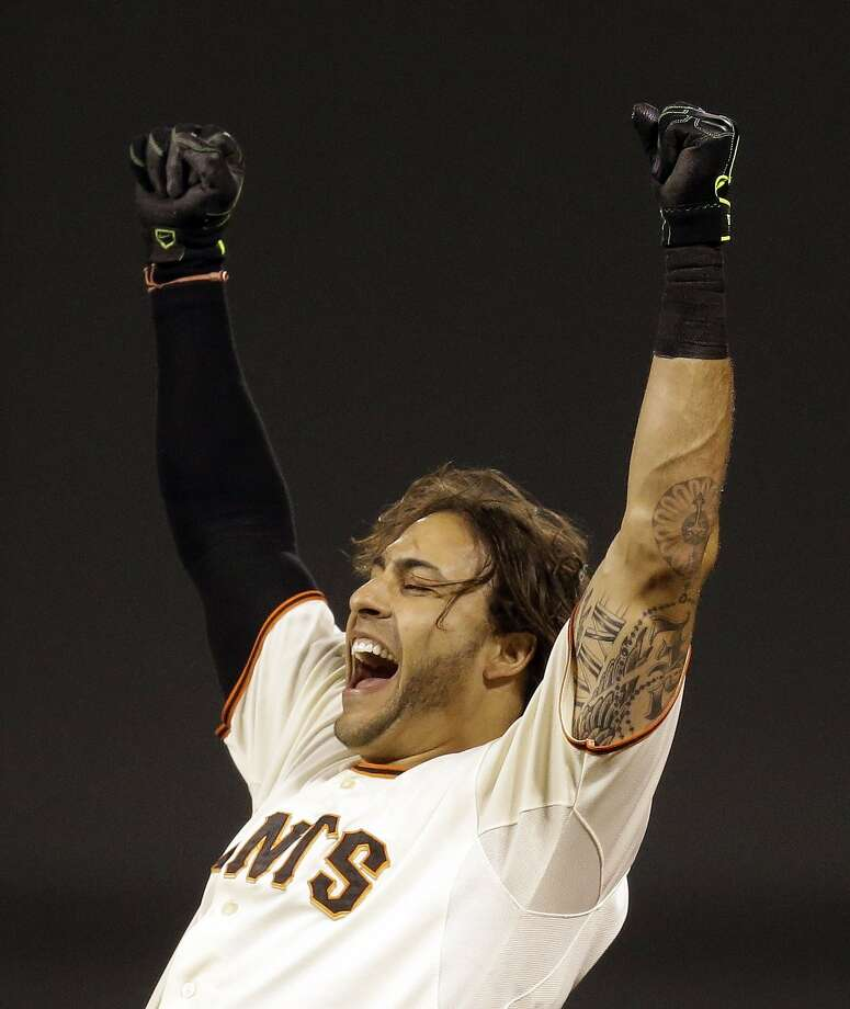 San Francisco Giants' Michael Morse celebrates after making the game winning hit in the ninth inning of a baseball game against the New York Mets Saturday, June 7, 2014, in San Francisco. (AP Photo/Ben Margot) Photo: Ben Margot, Associated Press