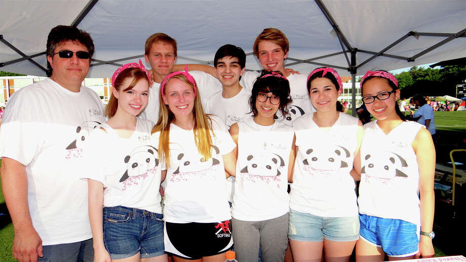 Local high school students form the fundraising team Pink Pandas for Saturday's annual Relay for Life fundraiser benefiting the American Cancer Society. Photo: Mike Lauterborn / Westport News