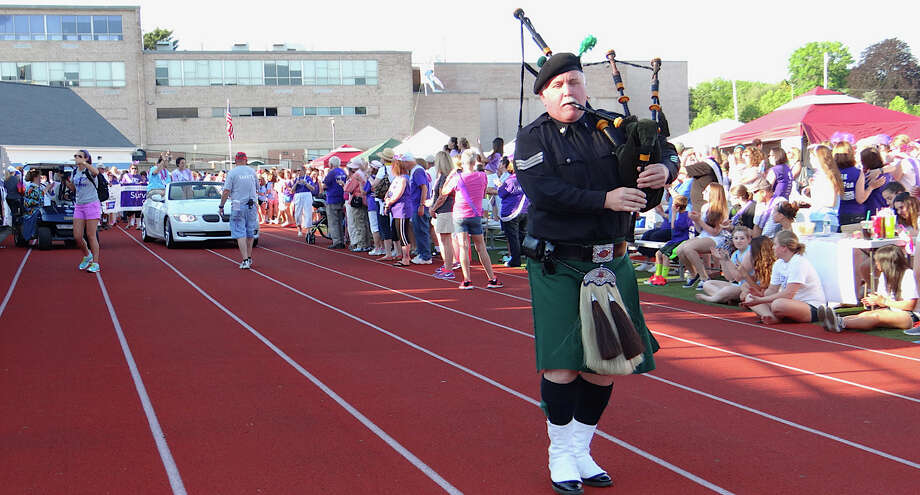 A piper leads the Survivors Lap to begin the Fairfield Relay for Life fundraiser for the American Cancer Society. Photo: Mike Lauterborn / Fairfield Citizen