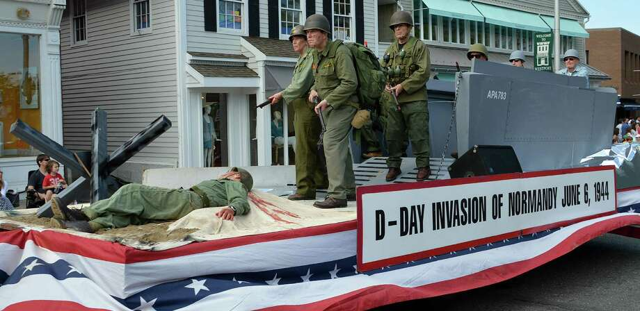 "Westport News columnist Dan Woog writes of the Y's Men float in this year's Memorial Day parade: ""One Westporter was concerned that the winning float ó the Yís Menís depiction of D-Day, the momentous battle fought exactly 70 years ago ó featured a soldier lying dead, covered in blood. ìThere were kids watching this parade!î the complainant actually said. Well, yeah. Itís Memorial Day. Itís a day for thinking about the millions of Americans who fought for our country ó particularly those who never returned. They did not die of old age, in their sleep."" Photo: Jarret Liotta / Westport News"