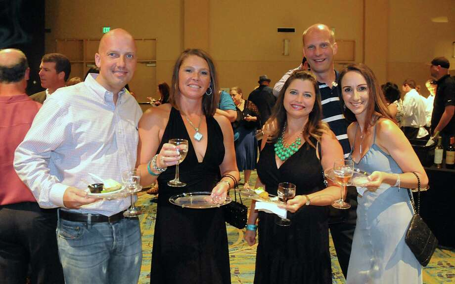 Christian Selchau, Jennifer Powner, Julia Warren, Rick Warren, and Amy Tuley, all of The Woodlands, enjoy the Wine Rendezvous Grand Tasting, a part of Wine Week, at The Woodlands Waterway Marriott.  Photo: David Hopper, For The Chronicle / freelance