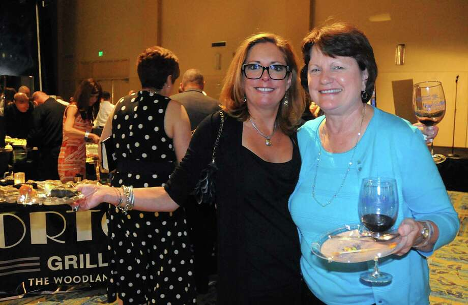 Robin Rambin, of Kansas City, Mo., came to enjoy Wine Week with her friend Debbie Spears, of Kingwood, during the Wine Rendezvous Grand Tasting, a part of Wine Week, at The Woodlands Waterway Marriott. Photo: David Hopper, For The Chronicle / freelance