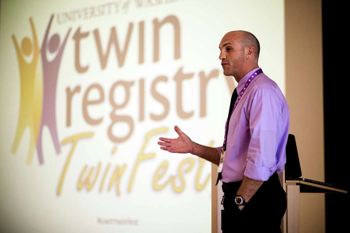 UW Twin Registry director Glen Duncan speaks at the first-ever Twinfest Saturday, June 7, 2014, at the University of Washington in Seattle. More than 120 pairs of twins met at the event.