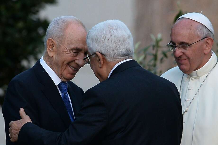 Israeli President Shimon Peres (left) shakes hands with Palestinian leader Mahmoud Abbas at a meeting with Pope Francis. The Mideast leaders planted an olive tree in the Vatican gardens as a peace gesture. Photo: Filippo Monteforte, AFP/Getty Images