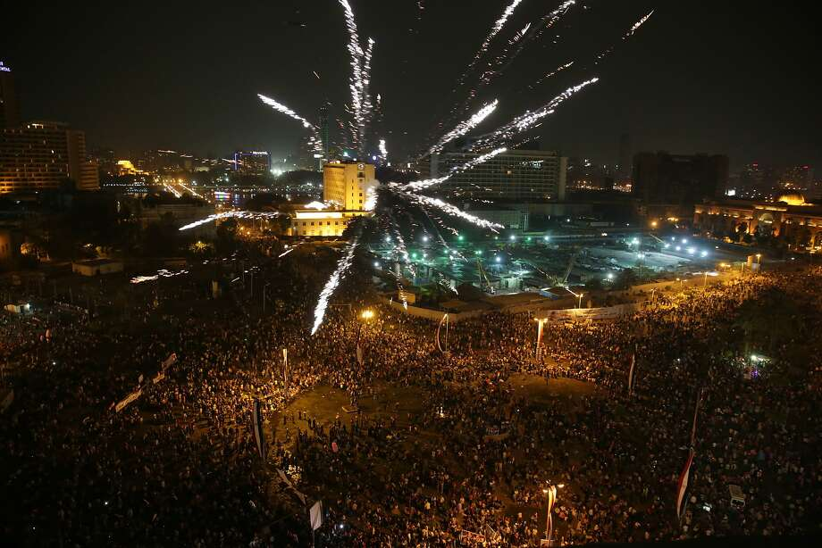 Supporters of President Abdel-Fattah el-Sissi celebrate his inauguration in Cairo's Tahrir Square. Photo: Thomas Hartwell, Associated Press