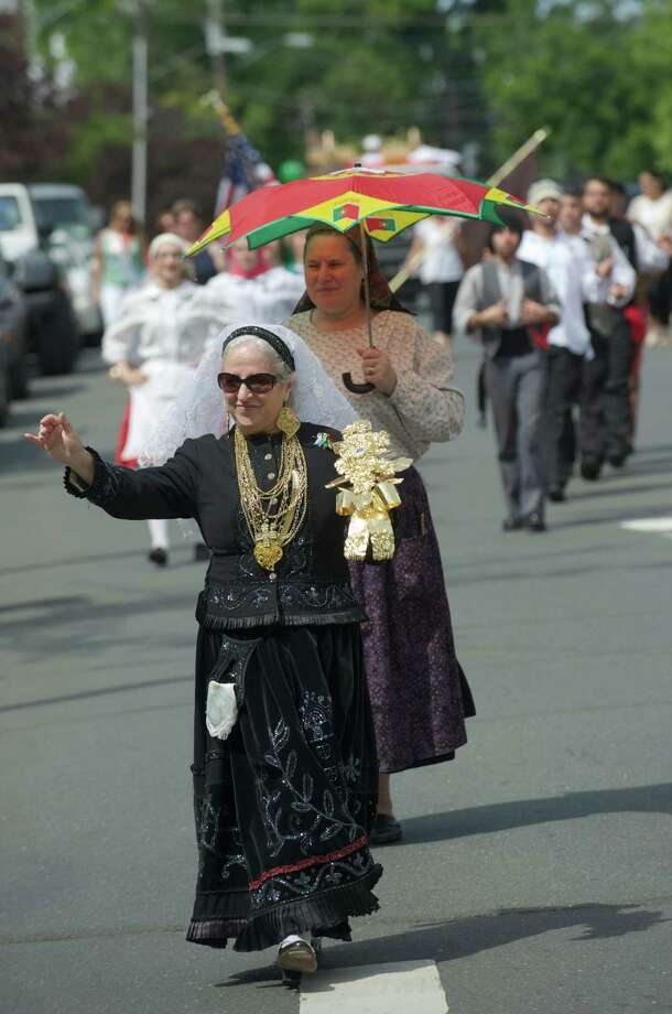 Maria Pereira, 61, of Danbury walks in the annual Portuguese Day Parade in Danbury, Conn, on Sunday, June 8, 2014. Pereira is a member of the Sons of Portugal Folk Dance group. Photo: H John Voorhees III / The News-Times Freelance