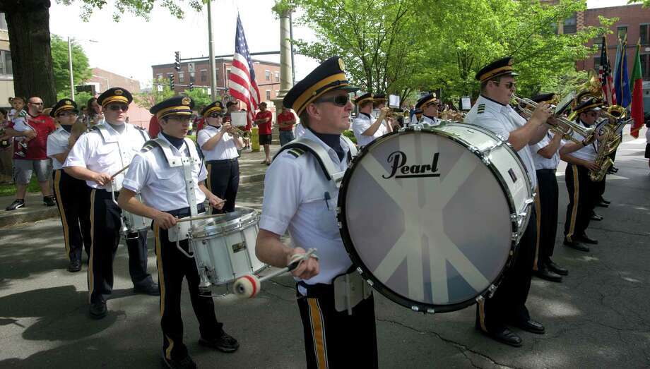 Ian Glen, 57, of Bethel, plays the bass drum in the Sons of Portugal Band in front of the Danbury Library during the annual Portuguese Day Parade in Danbury, Conn, on Sunday, June 8, 2014. Photo: H John Voorhees III / The News-Times Freelance