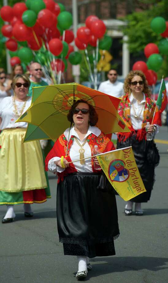 Connie Violante, of Danbury, walks along West Street in the annual Portuguese Day Parade in Danbury, Conn, on Sunday, June 8, 2014. Photo: H John Voorhees III / The News-Times Freelance