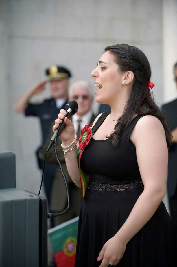 Andrea Sousa, of Danbury, sings the Star Spangled Banner on the steps of the Danbury Library as part of the  annual Portuguese Day Parade in Danbury, Conn, on Sunday, June 8, 2014. Photo: H John Voorhees III / The News-Times Freelance