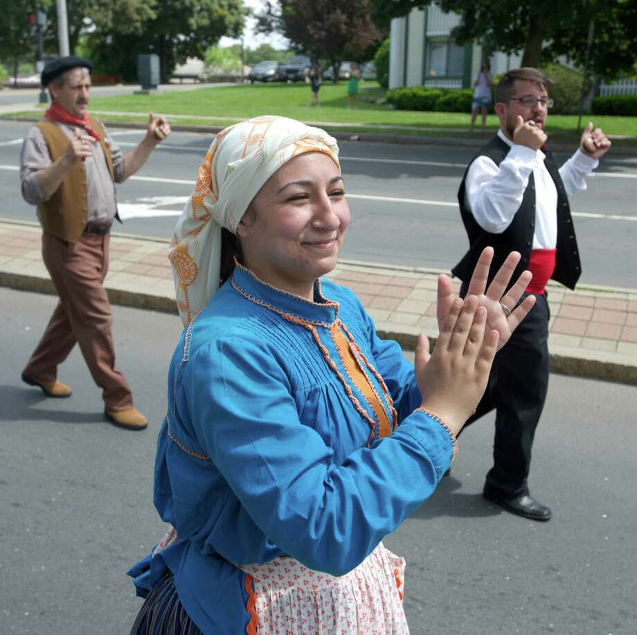 Diane Figueireeo, of Danbury, danced her way through the annual Portuguese Day Parade in Danbury, Conn, on Sunday, June 8, 2014. Figueireeo is from the Portuguese Cultural Center Folk Dance group, in Danbury. Photo: H John Voorhees III / The News-Times Freelance