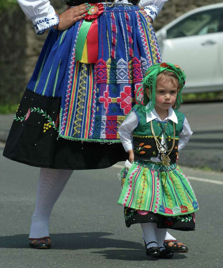 Gabriella Rosa, 2, of Danbury, walks in the annual Portuguese Day Parade in Danbury, Conn, on Sunday, June 8, 2014. She was getting gentile reminders from her aunt and godmother Kelly Alves, 21, walking behind her,  to keep her hands on her hips and to follow the yellow line. Photo: H John Voorhees III / The News-Times Freelance
