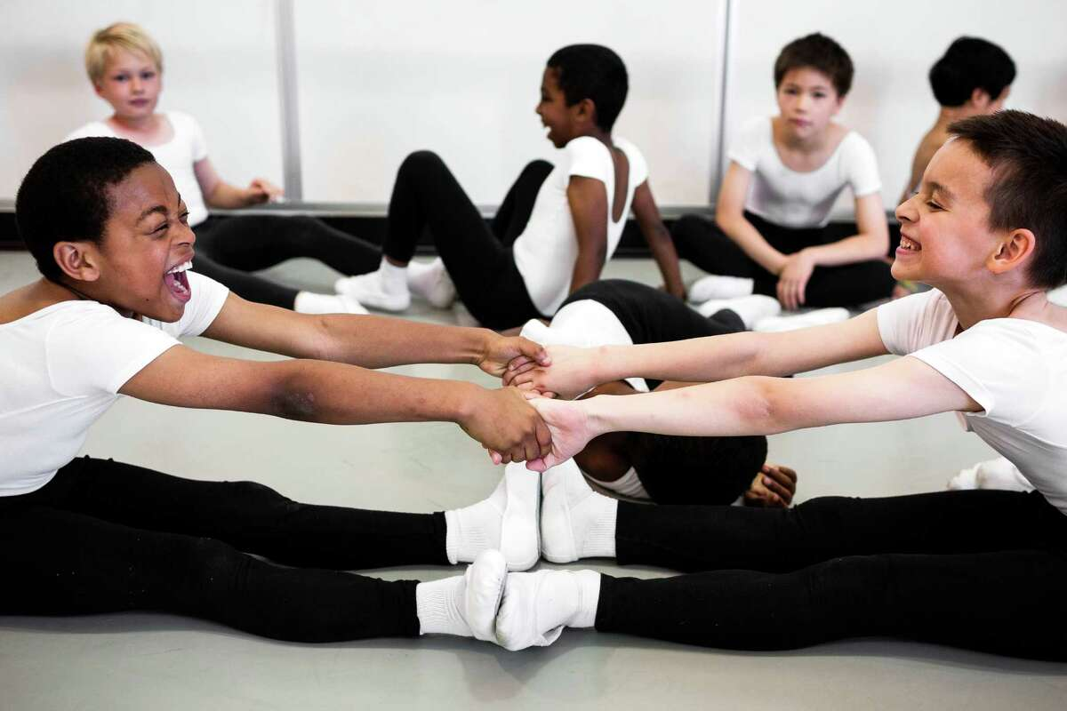 Young boys stretch out in preparation for their ballet performance at the 20th Annual DanceChance Observation Day Sunday, June 8, 2014, at Pacific Northwest Ballet in Seattle. The goal of DanceChance is to discover public school students and provide them with an opportunity to pursue a dance career that might not otherwise be theirs.