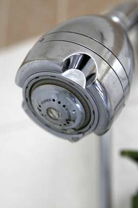Josh and Cynthia Kelly have installed water saving shower heads for conservation, at their apartment in San Francisco, CA, Saturday June 7, 2014.