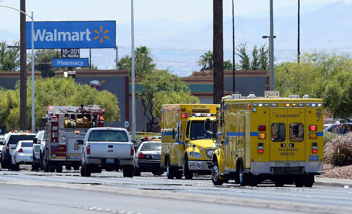 LAS VEGAS, NV - JUNE 08: Police and fire vehicles line the street outside a Wal-Mart on June 8, 2014 in Las Vegas, Nevada. Two officers were reported shot and killed by two assailants at a pizza restaurant near the Wal-mart. The two suspects then reportedly went into the Wal-Mart where they killed a third person before killing themselves. (Photo by Ethan Miller/Getty Images)
