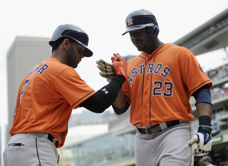 June 8: Astros 14, Twins 5Jonathan Villar congratulates teammate Chris Carter on a grand slam. Photo: Hannah Foslien, Getty Images