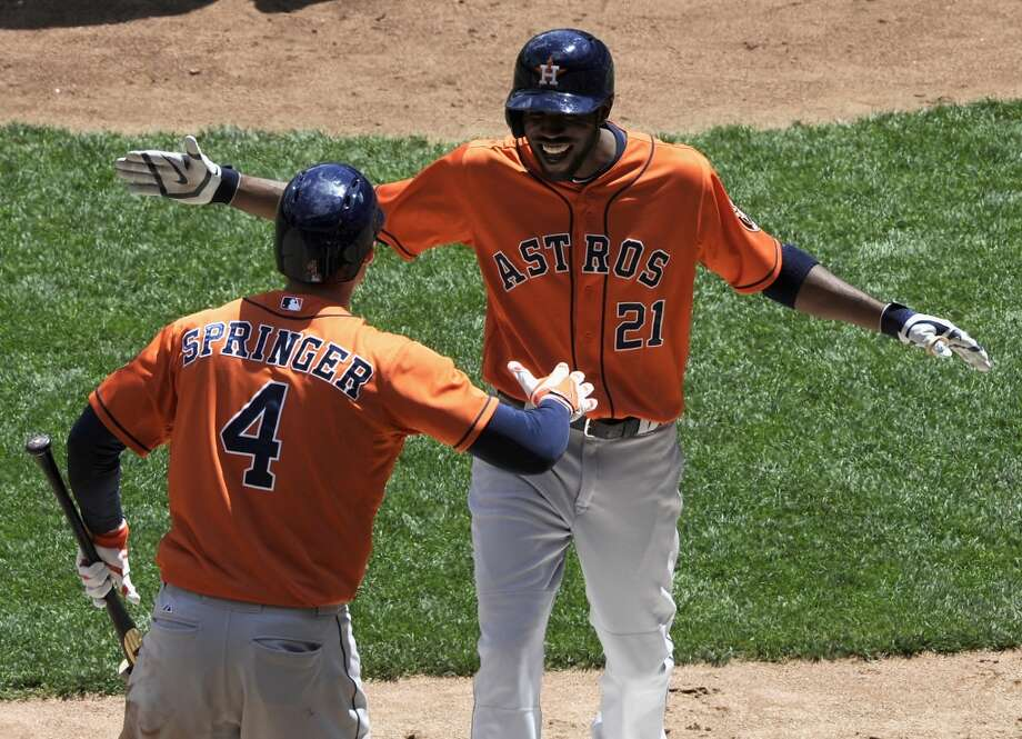 George Springer congratulates Dexter Fowler after his solo home run. Photo: Hannah Foslien, Getty Images