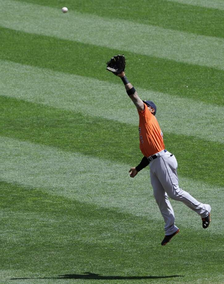 Jonathan Villar is unable to catch a ball hit by Danny Santana. Photo: Hannah Foslien, Getty Images