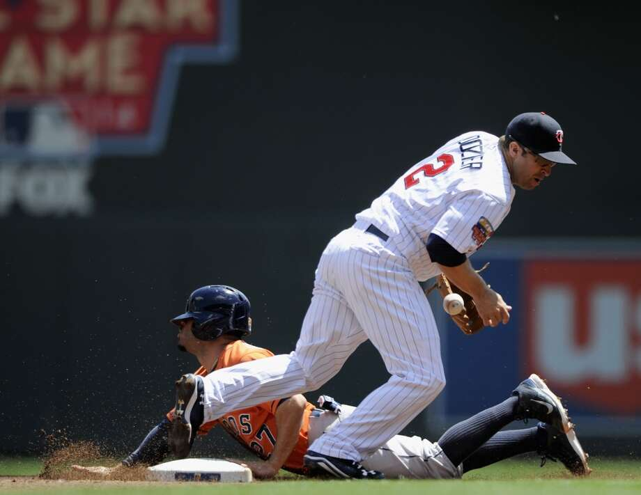 Jose Altuve steals second base as Brian Dozier fields the ball. Photo: Hannah Foslien, Getty Images