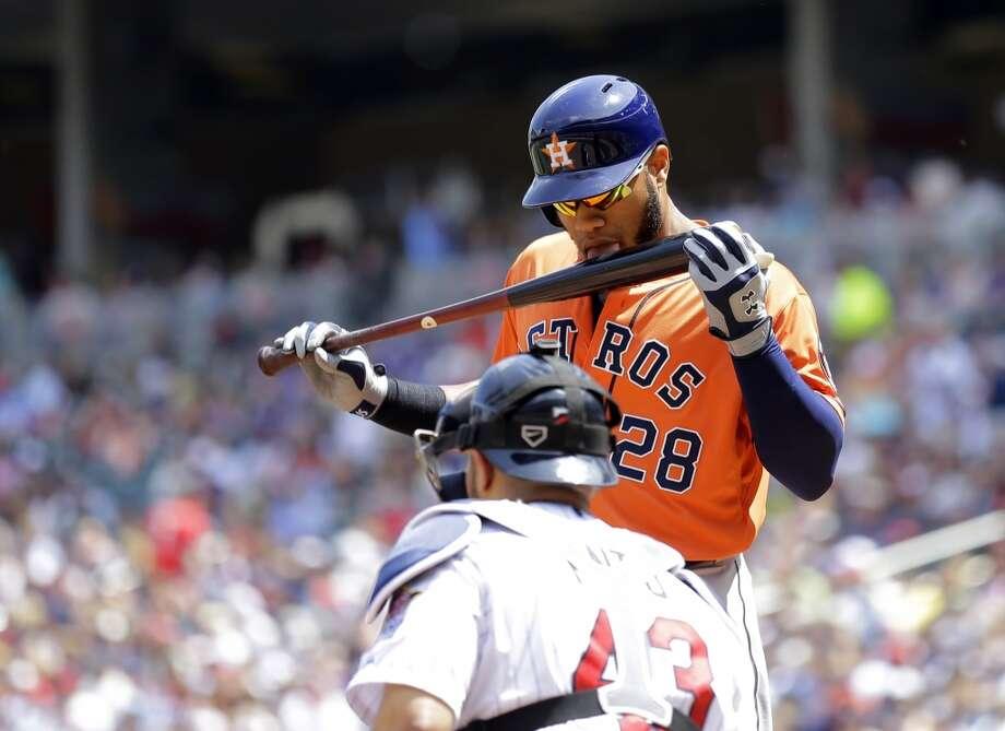 Jon Singleton licks his bat before batting. Photo: Ann Heisenfelt, Associated Press