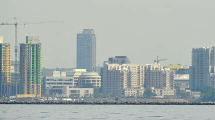 The Stamford skyline can be seen before the start of the 29th annual Mayor's Cup Race on the Long Island Sound off shore from Stamford, Conn., on Sunday, June 8, 2014. The sailboat regatta was later cancelled due to a lack of wind.
