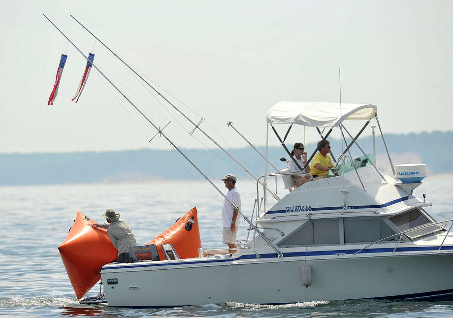 Scenes from the 29th annual Mayor's Cup Race on the Long Island Sound off shore from Stamford, Conn., on Sunday, June 8, 2014. The sailboat regatta was later cancelled due to a lack of wind. Photo: Jason Rearick / Stamford Advocate