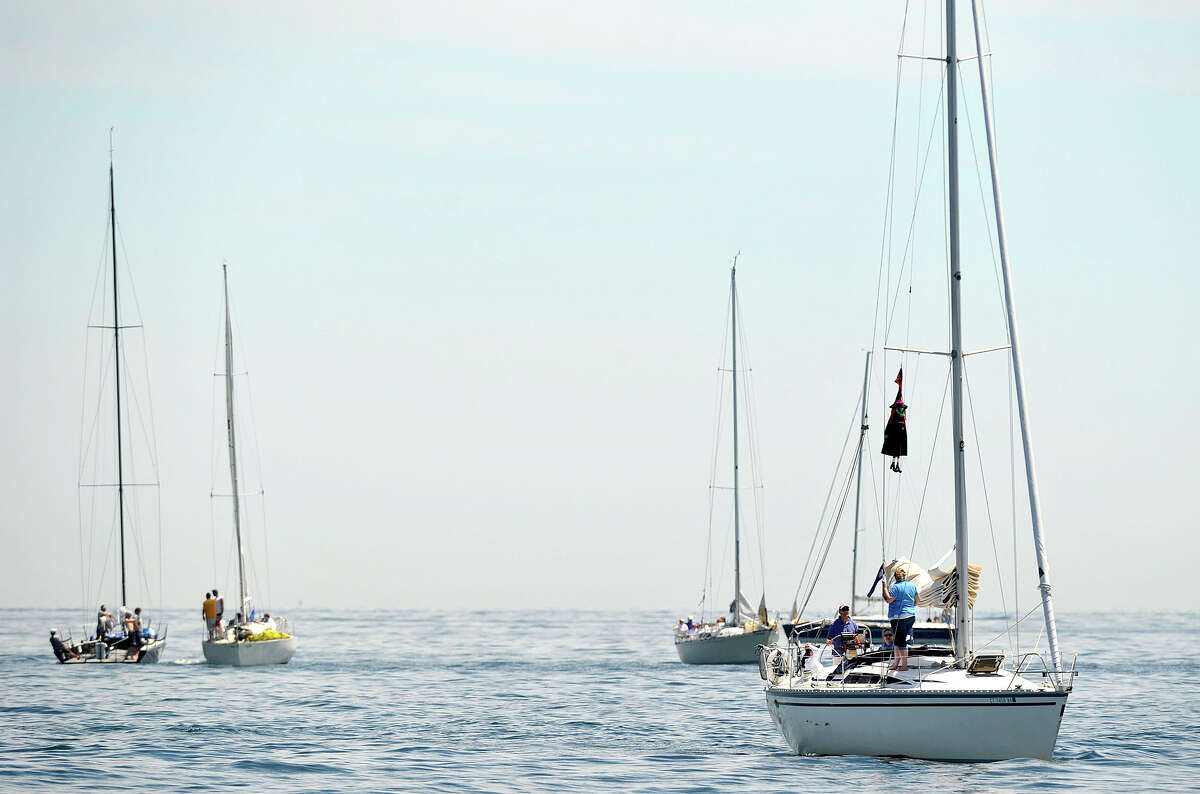 Scenes from the 29th annual Mayor's Cup Race on the Long Island Sound off shore from Stamford, Conn., on Sunday, June 8, 2014. The sailboat regatta was later cancelled due to a lack of wind.