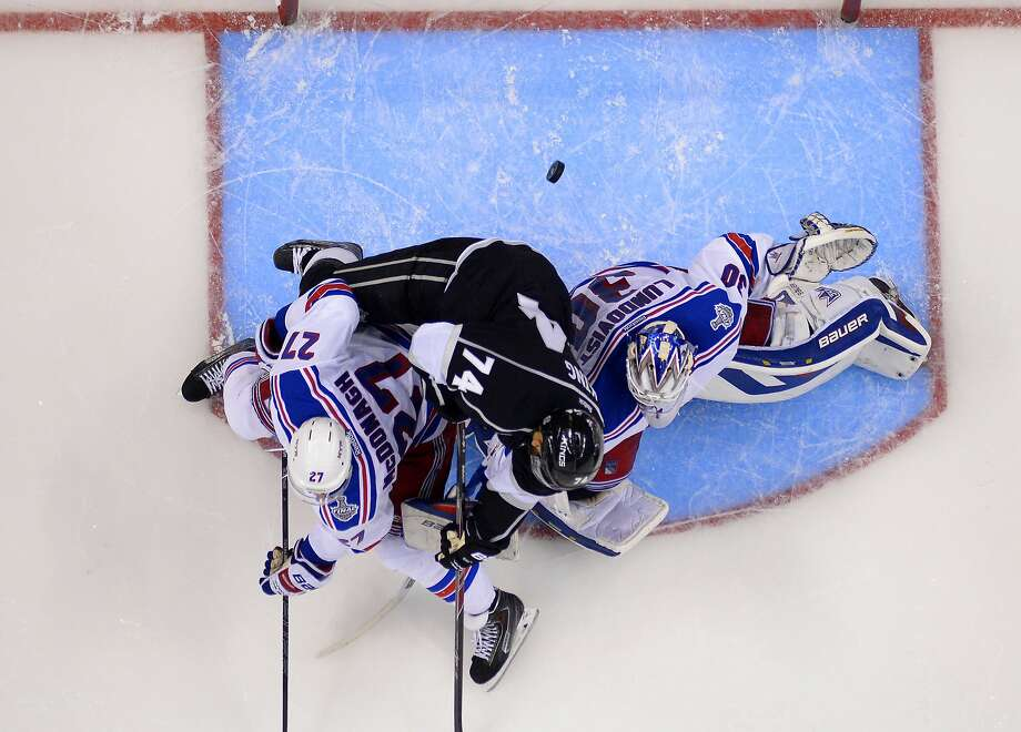 Los Angeles' Dwight King scores between New York's Ryan McDonagh (left) and goalie Henrik Lundqvist in Game 2. Photo: Mark J. Terrill, Associated Press
