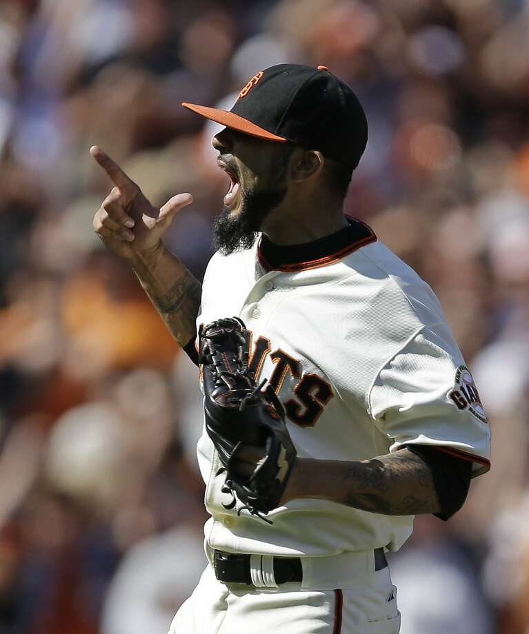 Closer Sergio Romo celebrates after getting the last out in Sunday's win over the Mets. Photo: Ben Margot, Associated Press