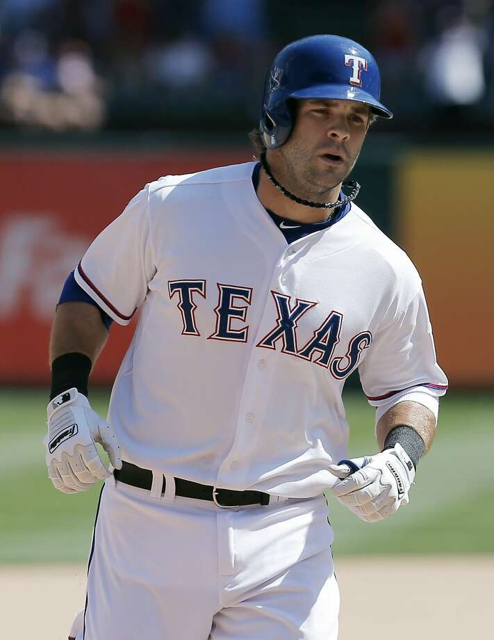 Texas' Mitch Moreland could miss the rest of the season. Photo: Brandon Wade, Getty Images