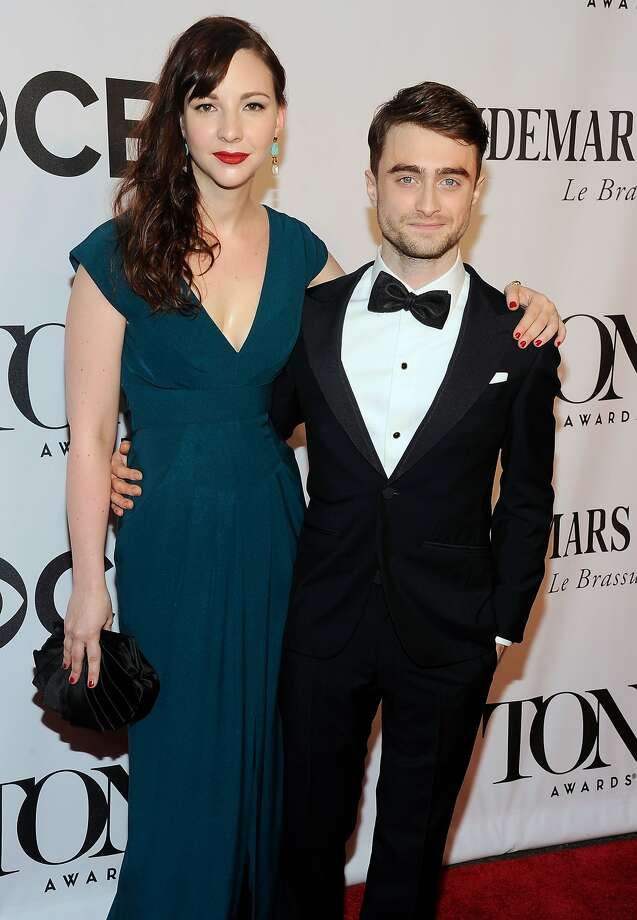 Daniel Radcliffe, right, and Erin Darke arrive at the 68th annual Tony Awards at Radio City Music Hall on Sunday, June 8, 2014, in New York. (Photo by Charles Sykes/Invision/AP) Photo: Charles Sykes, Associated Press