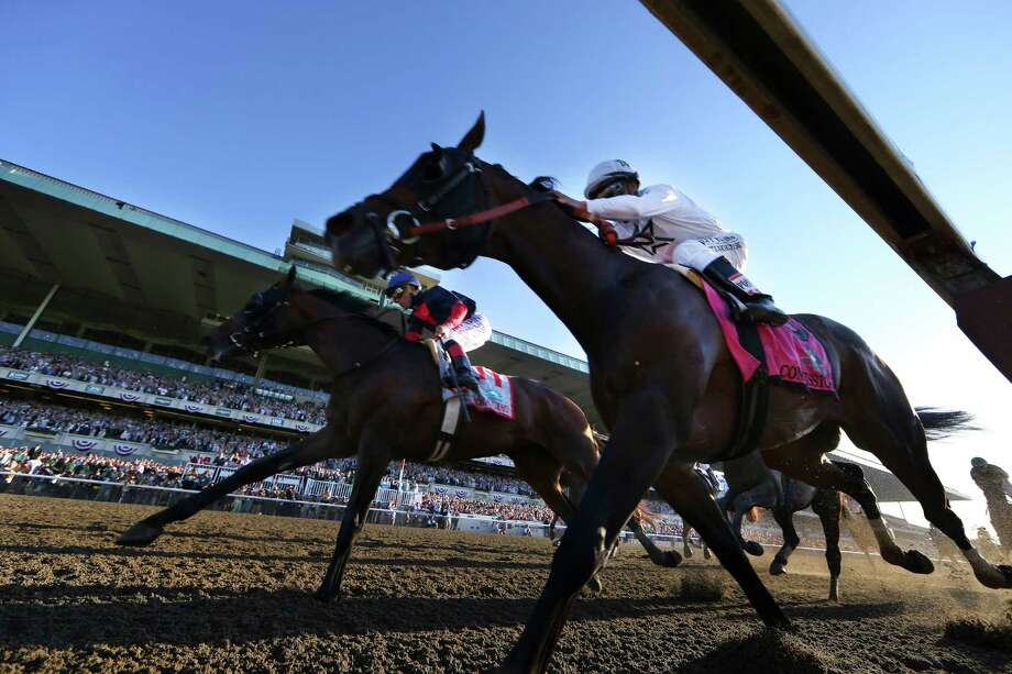 Tonalist, left, catches Commissioner at the finish line to win the 146th running of the Belmont Stakes, in Elmont, N.Y., June 7, 2014. Running from the outside gate, Tonalist foiled California Chrome's bid to become the first Triple Crown winner since 1978. (Chang W. Lee/The New York Times) ORG XMIT: XNYT95 Photo: CHANG W. LEE / NYTNS