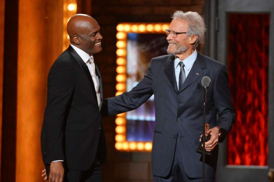 "Clint Eastwood (R) presents Kenny Leon with the award for ""A Raisin in the Sun"" onstage during the 68th Annual Tony Awards at Radio City Music Hall on June 8, 2014 in New York City.  Photo: Theo Wargo, (Credit Too Long, See Caption)"