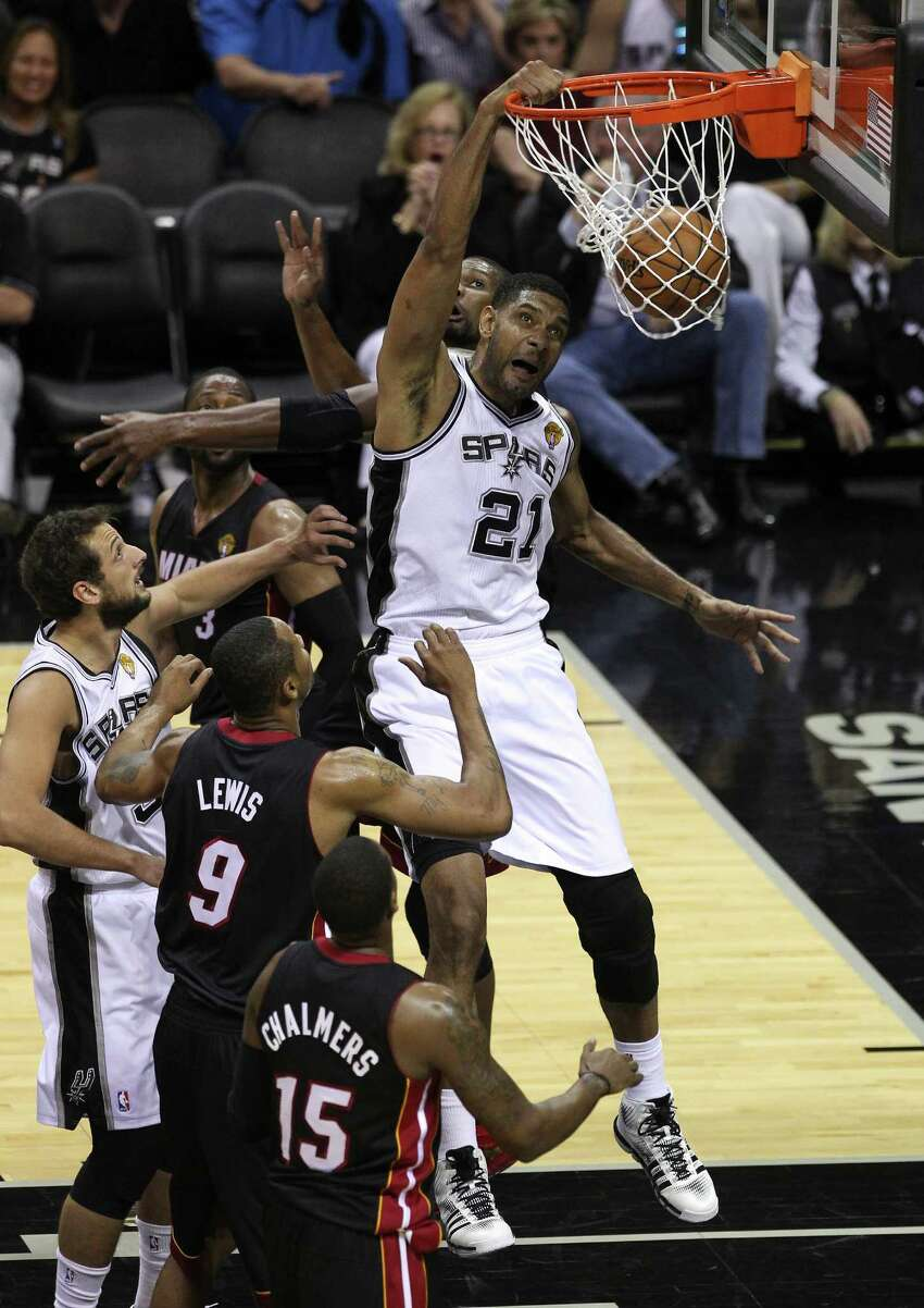 Spurs' Tim Duncan (21) dunks against the Miami Heat in the first half of Game 2 of the 2014 NBA Finals at the AT&T Center on Sunday, June 8, 2014.