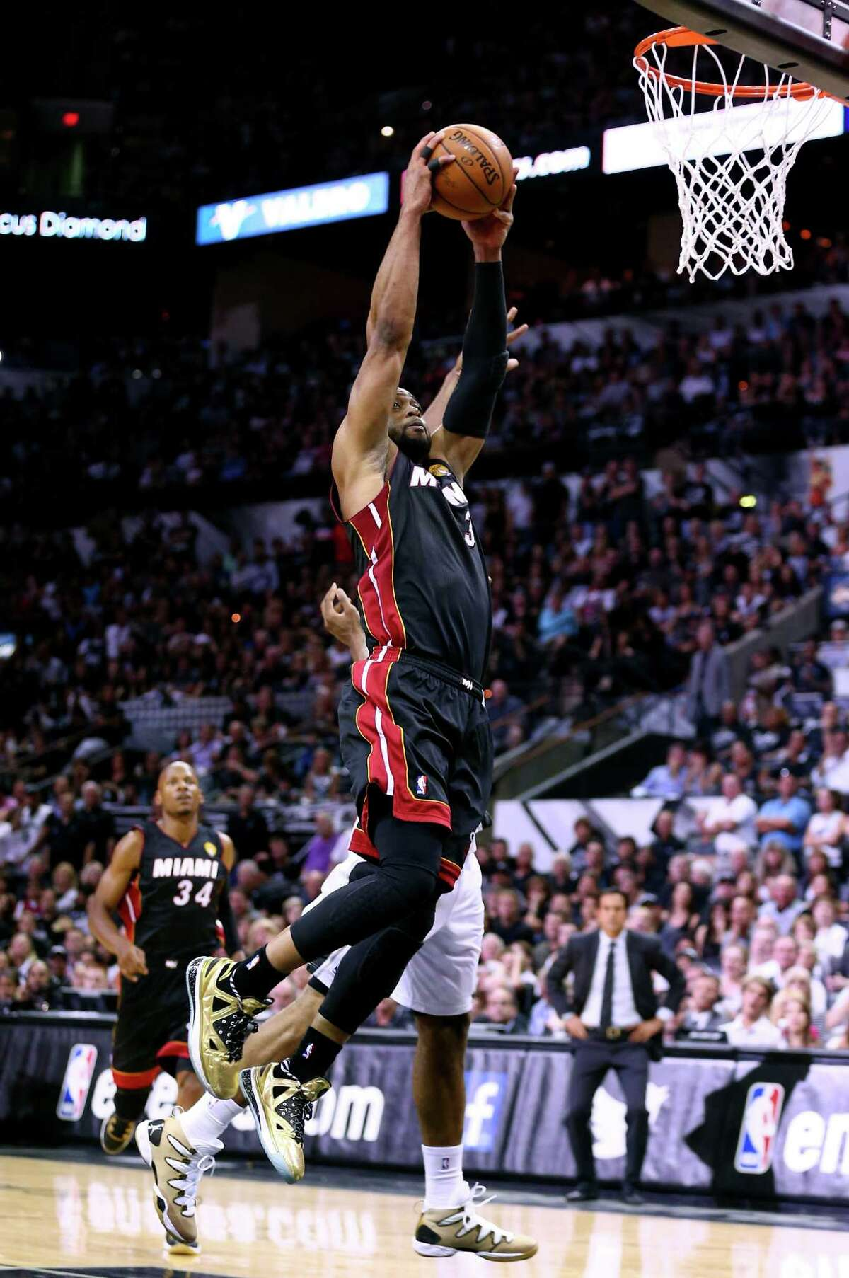 SAN ANTONIO, TX - JUNE 08: Dwyane Wade #3 of the Miami Heat goes to the basket agianst the San Antonio Spurs during Game Two of the 2014 NBA Finals at the AT&T Center on June 8, 2014 in San Antonio, Texas. NOTE TO USER: User expressly acknowledges and agrees that, by downloading and or using this photograph, User is consenting to the terms and conditions of the Getty Images License Agreement.