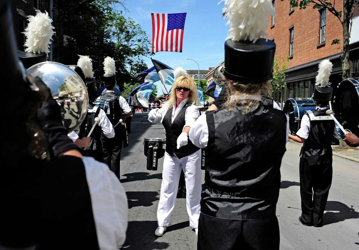 Donel Mataruga, director/drum major of the Excelsior Drum and Bugle Corps out of Troy, leads the band members as they perform in the 47th Annual Troy Flag Day Parade on Sunday, June 8, 2014, in Troy, N.Y. (Paul Buckowski / Times Union)