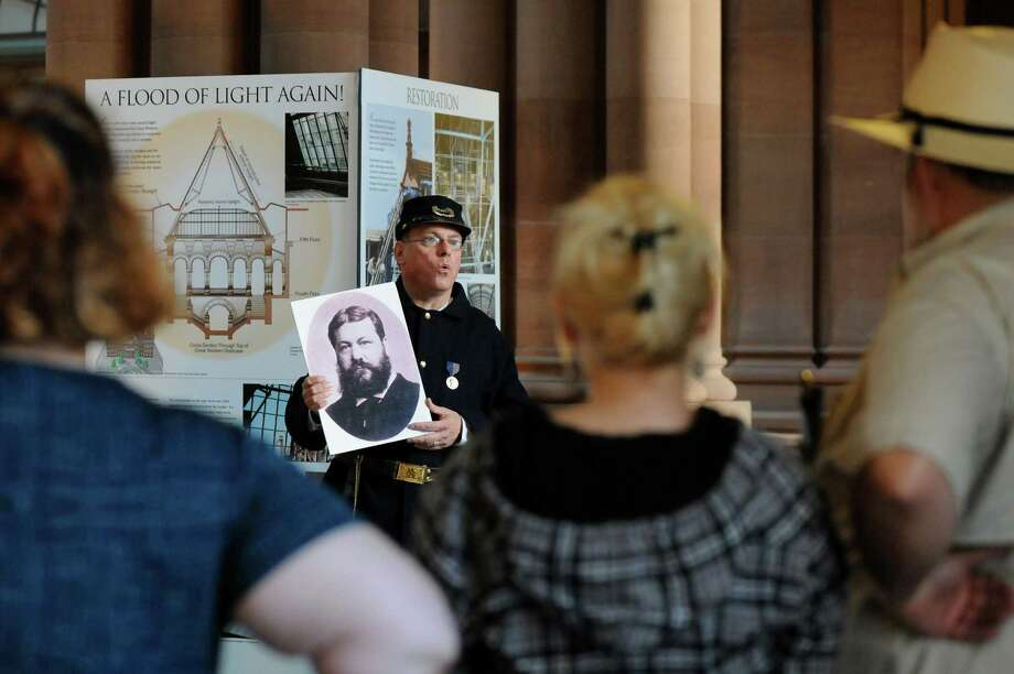 Education coordinator Stuart Lehman, center, talks about architect Henry Hobson Richardson during a Civil War tour on Thursday, June 5, 2014, at the Capitol in Albany, N.Y. (Cindy Schultz / Times Union) Photo: Cindy Schultz / 00027126A