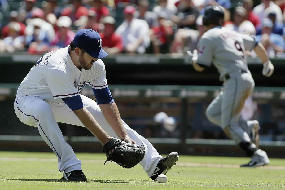 Rangers pitcher Joe Saunders fields a hit and subsequently throws out Ryan Raburn in the fifth. Photo: Brandon Wade / Associated Press / FR168019 AP