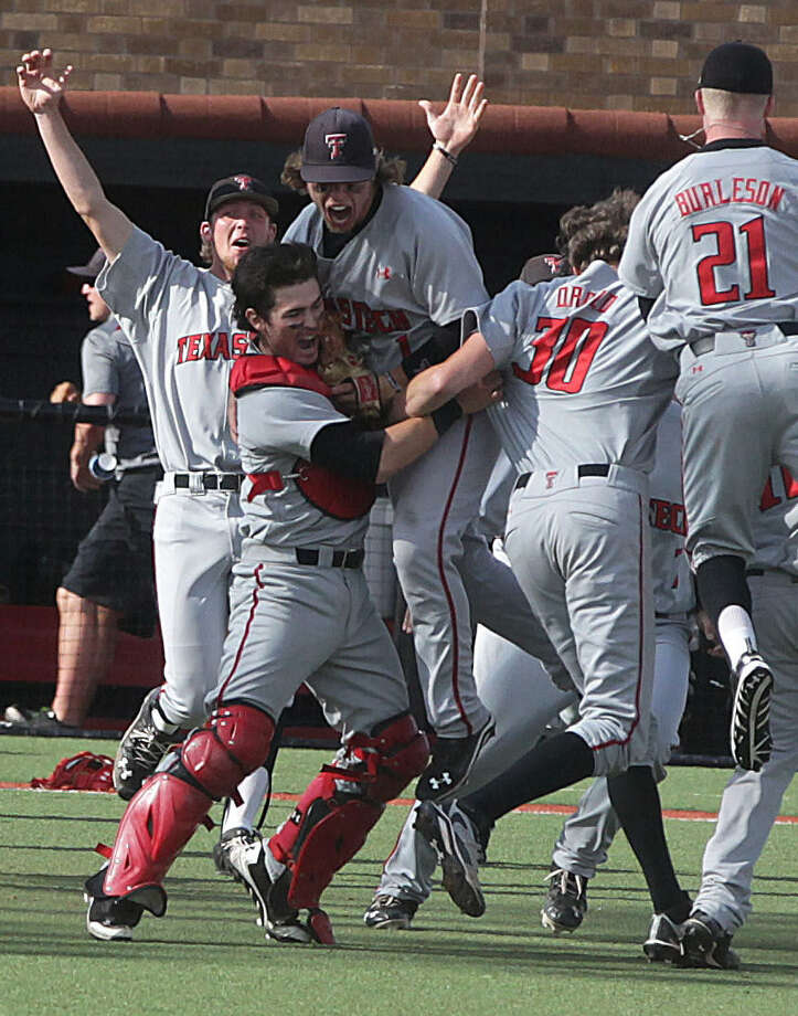 Texas Tech players rejoice after their second win over College of Charleston in as many days clinched their first CWS berth.                    C4 Photo: Shannon Wilson / Lubbock Avalanche-Journal / Lubbock Avalanche-Journal
