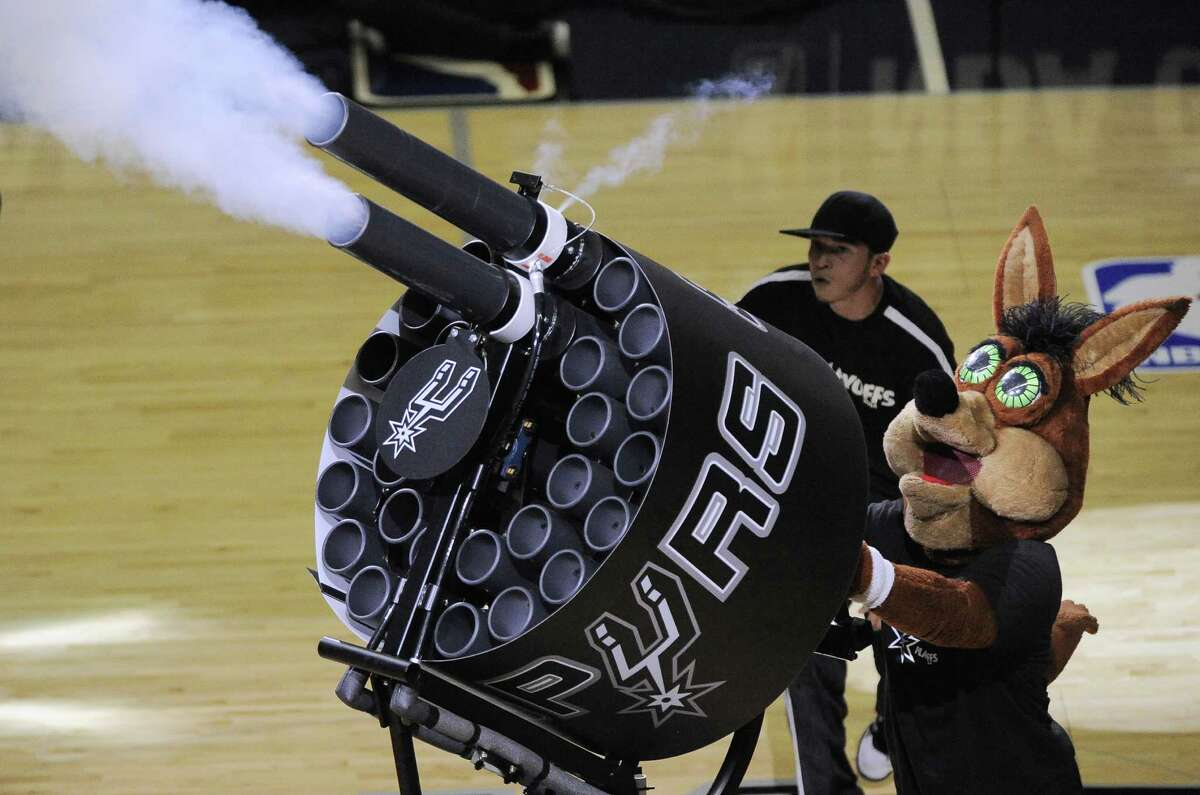 The San Antonio Spurs Coyote fires T-shirts into the crowd during the second half of Game 1 of a Western Conference finals NBA basketball playoff series against the Oklahoma City Thunder, Monday, May 19, 2014, in San Antonio. San Antonio won 122-105. (AP Photo/Darren Abate)