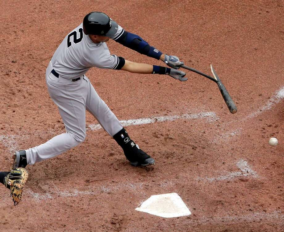 New York Yankees' Derek Jeter breaks his bat as he grounds out during the seventh inning of a baseball game against the Kansas City Royals Sunday, June 8, 2014, in Kansas City, Mo. (AP Photo/Charlie Riedel) ORG XMIT: MOCR113 Photo: Charlie Riedel / AP