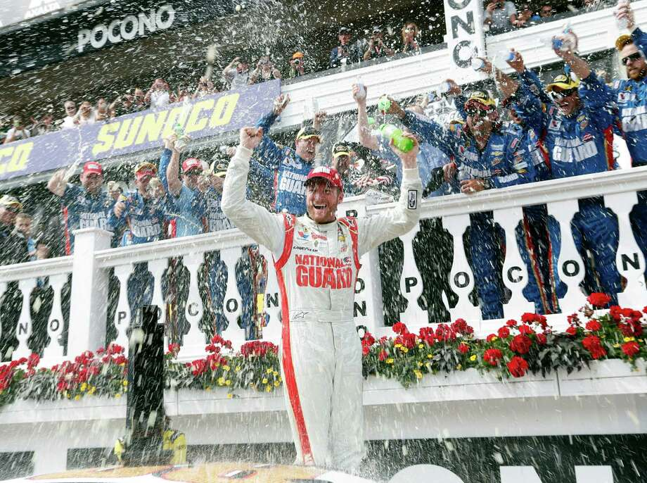 Dale Earnhardt Jr. celebrates after winning the NASCAR Sprint Cup Series Pocono 400 auto race at Pocono Raceway on Sunday, June 8, 2014, in Long Pond, Pa. (AP Photo/Mike Groll) ORG XMIT: PAMG101 Photo: Mike Groll / AP